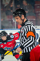 KELOWNA, BC - NOVEMBER 8: Referee Jeff Ingram stands at center ice to drop the puck between the visiting Medicine Hat Tigers at the Kelowna Rockets  at Prospera Place on November 8, 2019 in Kelowna, Canada. (Photo by Marissa Baecker/Shoot the Breeze)