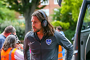 Portsmouth defender Christian Burgess (6) arrives ahead of  the EFL Cup match between Queens Park Rangers and Portsmouth at the Kiyan Prince Foundation Stadium, London, England on 28 August 2019.