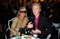 ANITA PALLENBERG and Milliner PHILIP TREACY at a party to celebrate 'Made in Italy at Harrods' - a celebration of Italian fashion food and wine, design and interiors, art and photography, cinema and music, beauty and glamour.  The party was held in the Georgian Restaurant at Harrods, Knightsbridge, London on 9th September 2004.<br />