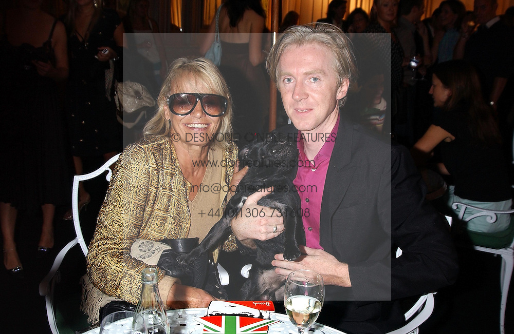 ANITA PALLENBERG and Milliner PHILIP TREACY at a party to celebrate 'Made in Italy at Harrods' - a celebration of Italian fashion food and wine, design and interiors, art and photography, cinema and music, beauty and glamour.  The party was held in the Georgian Restaurant at Harrods, Knightsbridge, London on 9th September 2004.<br /><br />PICTURES LICENCED UNTIL 9/3/2004 FOR USE TO PROMOTE THE 'MADE IN ITALY' EVENT/S ONLY.