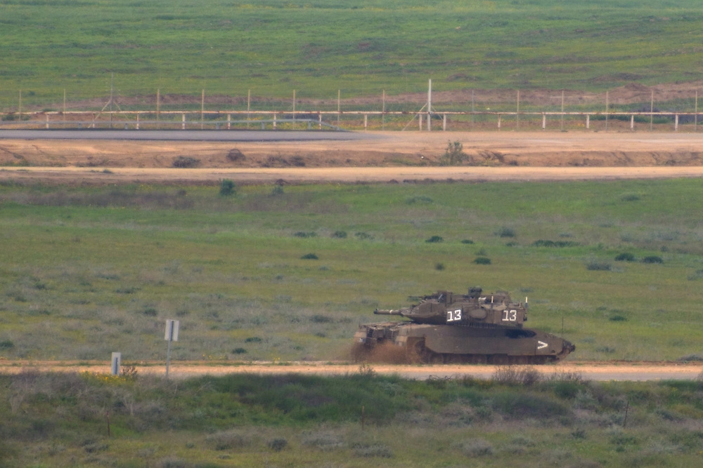 Israel-Gaza Border, MAR 13 2014: An Israeli tank patrols along Israel-Gaza border. Tension rises between Israel and Gaza following llaunch of dozens rockets towards Israel and Israeli Air Force attacks over Gaza. Photo by Gili Yaari
