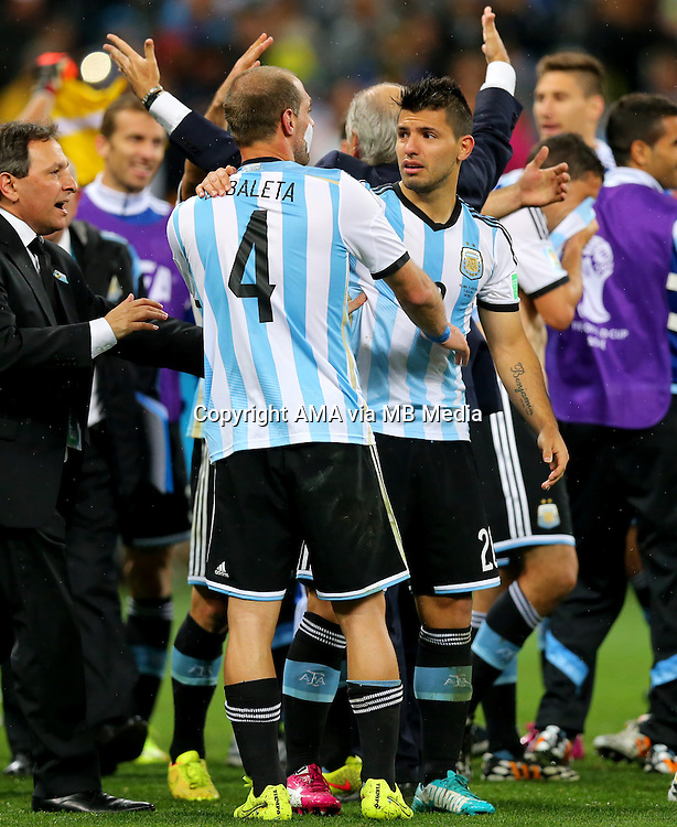 An emotional Sergio Aguero of Argentina celebrates with Manchester City team mate Pablo Zabaleta of Argentina after winning the penalty shootout 4-2 and earning a place in the FIFA World Cup final