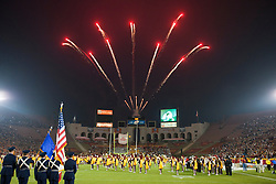 September 11, 2010; Los Angeles, CA, USA;  Fireworks go off during the national anthem before the game between the Southern California Trojans and the Virginia Cavaliers at the Los Angeles Memorial Coliseum. USC defeated Virginia 17-14.