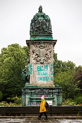 "© Licensed to London News Pictures. 10/06/2020. Leeds UK.  A statue of Queen Victoria at Hyde Park in Leeds has been sprayed with graffiti including the words ""murderer"" and ""slave owner"". The bronze sculpture on Woodhouse Moor in the Hyde Park area of the city also had the words ""coloniser"" and ""racist"" daubed on it. Several statues have been targeted after a statue of 17th Century slave trader Edward Colston was torn off its plinth in Bristol by protesters. Photo credit: Andrew McCaren/LNP"