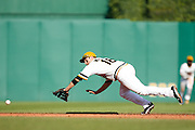 PITTSBURGH, PA - JUNE 30: Neil Walker #18 of the Pittsburgh Pirates dives to field a ground ball against the Milwaukee Brewers during the game at PNC Park on June 30, 2013 in Pittsburgh, Pennsylvania. The Pirates won 2-1 in 14 innings. (Photo by Joe Robbins)  Neil Walker