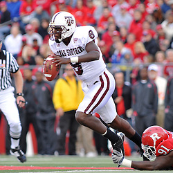 Oct 10, 2009; Piscataway, NJ, USA; Texas Southern quarterback Arvell Nelson (8) scrambles from Rutgers defensive tackle Justin Francis (91) during first half NCAA college football action between Rutgers and Texas Southern at Rutgers Stadium.