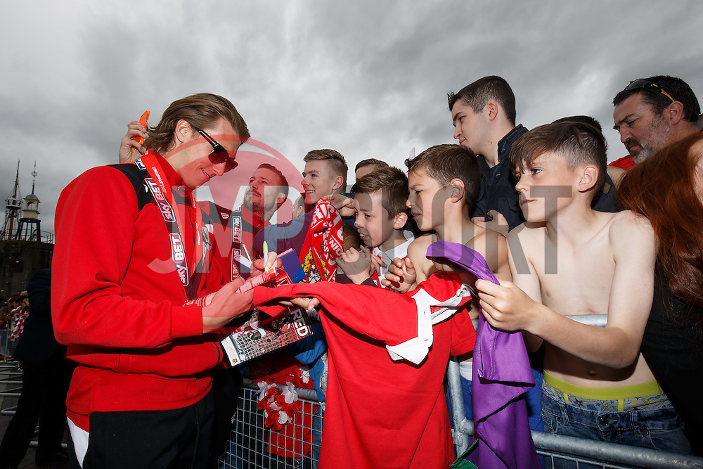 Luke Freeman and Wade Elliott interact with fans after the Bristol City open top bus parade to celebrate winning both the League 1 and Johnstone's Paint Trophy titles this season and promotion to the Championship - Photo mandatory by-line: Rogan Thomson/JMP - 07966 386802 - 04/05/2015 - SPORT - FOOTBALL - Bristol, England - Bristol City Bus Parade.
