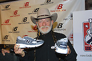 New Balance.Singer Willie Nelson shows off a specially made pair of sneakers with his name on the toe and heel