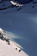 Josef Schumacher is climbing the north face of the peak Weisse Frau from the massiv Blueemlisalp, Berner Oberland, Switzerland