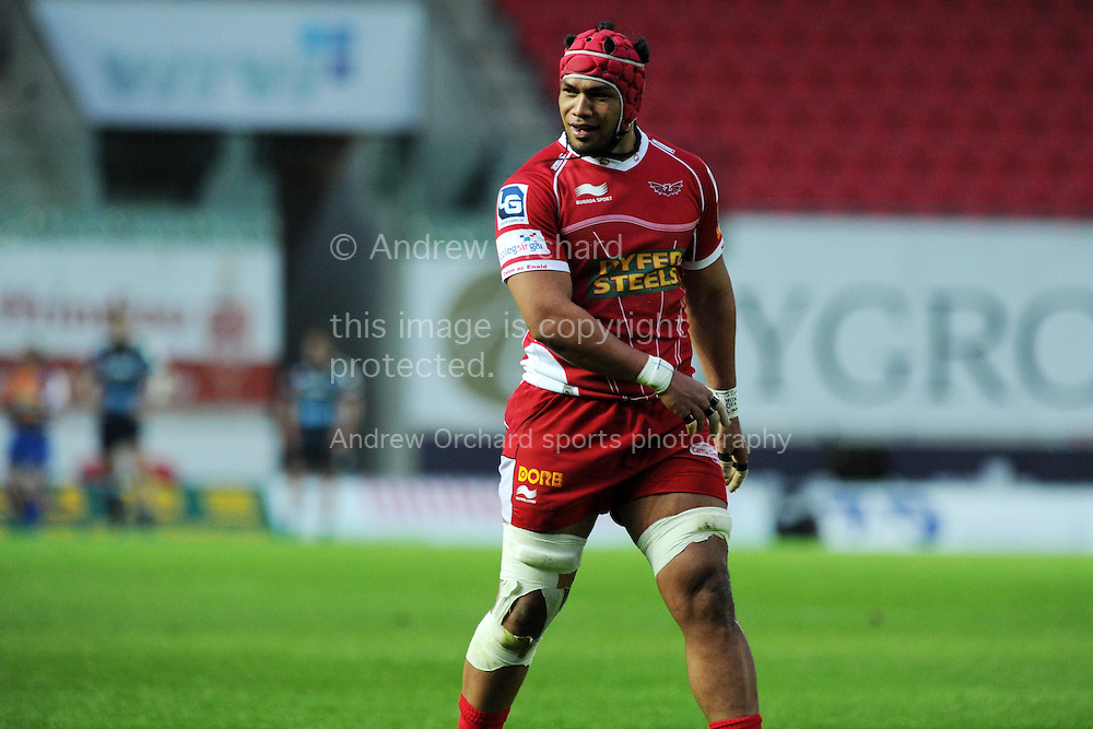 Sione Timani of the Scarlets looks on. Rabodirect Pro12 rugby union match, Scarlets v Cardiff Blues at Parc y Scarlets in Llanelli, South Wales on Sat 10th May 2014.<br /> pic by Andrew Orchard, Andrew Orchard sports photography.