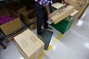 C&A clothes being boxed up ready for collection from an Epyllion Group factory in Bangladesh.