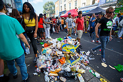 © Licensed to London News Pictures. 29/08/2016. London, UK. Revellers leave rubbish in the streets on the second day of Notting Hill Carnival in west London, Monday 29 August 2016. Photo credit: Tolga Akmen/LNP