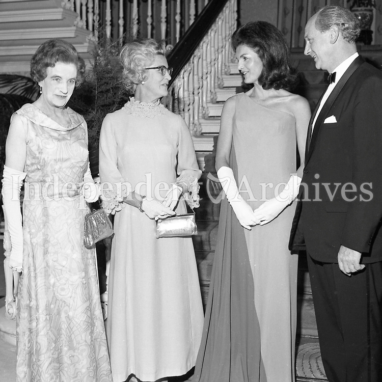 Jacqueline Kennedy's 1967 visit to Ireland.<br /> Mrs. Jackie Kennedy at a state banquet at St. Patrick's Hall, Dublin Castle, 30/06/1967.<br /> An Taoiseach Mr. Jack Lynch T.D. entertains Mrs. Jackie Kennedy at a reception at St. Patrick's Hall, Dublin Castle.<br /> Jackie Kennedy with her hosts Jack Lynch and his wife M&aacute;ir&iacute;n in the reception hall of Dublin Castle where she attended her first formal function since her arrival in Ireland. On the left is Mrs. Frank Aiken.<br /> (Part of the Independent Ireland Newspapers/NLI Collection)