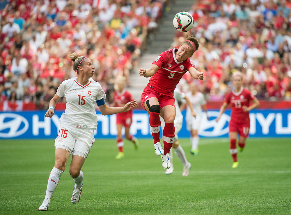 Caroline Abbe of team Switzerland (left)  and Josee Belanger of team Canada in 2015 women's World Cup Soccer in Vancouver during second round action between Canada and Switzerland