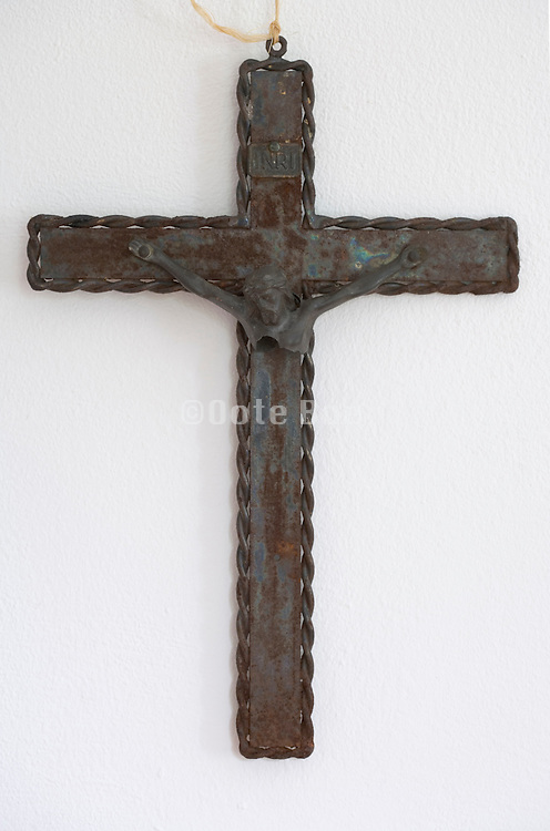 an old broken rusty cross