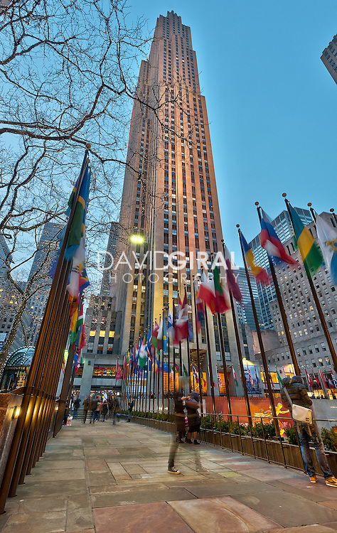 Rockefeller Center at dusk and flags, New-York City, US
