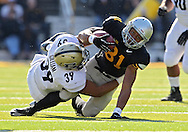 November 10 2012: Purdue Boilermakers linebacker Joe Gilliam (39) pulls down Iowa Hawkeyes wide receiver Tevaun Smith (81) after a catch during the NCAA football game between the Purdue Boilermakers and the Iowa Hawkeyes at Kinnick Stadium in Iowa City, Iowa on Saturday, November 10, 2012. Purdue defeated Iowa 27-24.