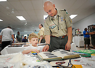 Isaiah Ponzuric, 8, and John Ponzuric of Doylestown, Pennsylvania view memorabilia on display during Ockanickon Scout Reservation's 75th anniversary celebration Saturday, June 18, 2016 in Pipersville, Pennsylvania.   (Photo by William Thomas Cain)