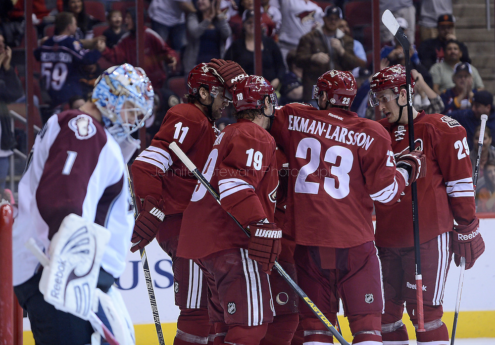 Apr. 6, 2013; Glendale, AZ, USA;  Phoenix Coyotes center Martin Hanzal (11) , right wing Shane Doan (19) , defenseman Oliver Ekman-Larsson (23) , defenseman Michael Stone (29) celebrate on the ice after right wing Shane Doan (19) scores a goal against Colorado Avalanche goalie Semyon Varlamov (1) in the second period at Jobing.com Arena. Mandatory Credit: Jennifer Stewart-USA TODAY Sports