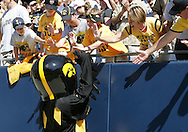 01 SEPTEMBER 2007: Iowa mascot Herky high-fives fans during Iowa's 16-3 win over Northern Illinois at Soldiers Field in Chicago, Illinois on September 1, 2007.