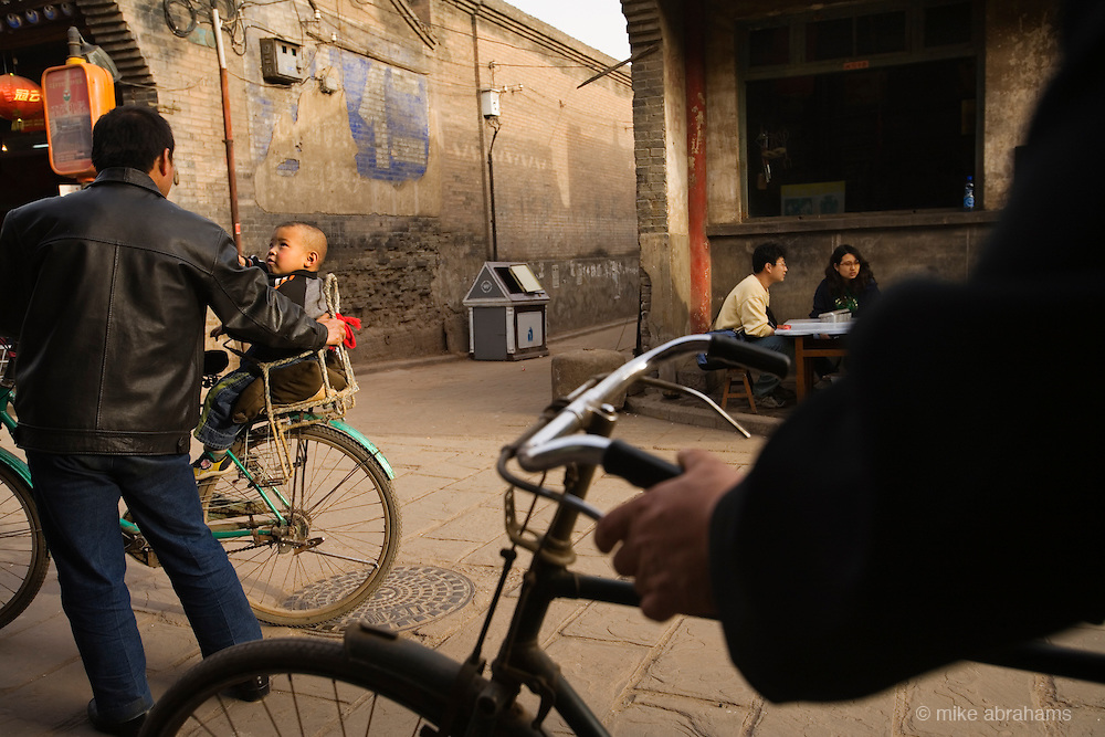 Bicycles on a dusty street in Pingyao, People's Republic of China