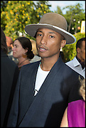 PHARRELL WILLIAMS, 2014 Serpentine's summer party sponsored by Brioni.with a pavilion designed this year by Chilean architect Smiljan Radic  Kensington Gdns. London. 1July 2014