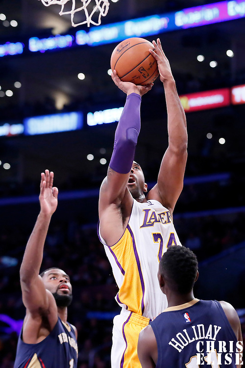 07 December 2014: Los Angeles Lakers guard Kobe Bryant (24) takes a jump shot over New Orleans Pelicans guard Jrue Holiday (11) during the New Orleans Pelicans 104-87 victory over the Los Angeles Lakers, at the Staples Center, Los Angeles, California, USA.
