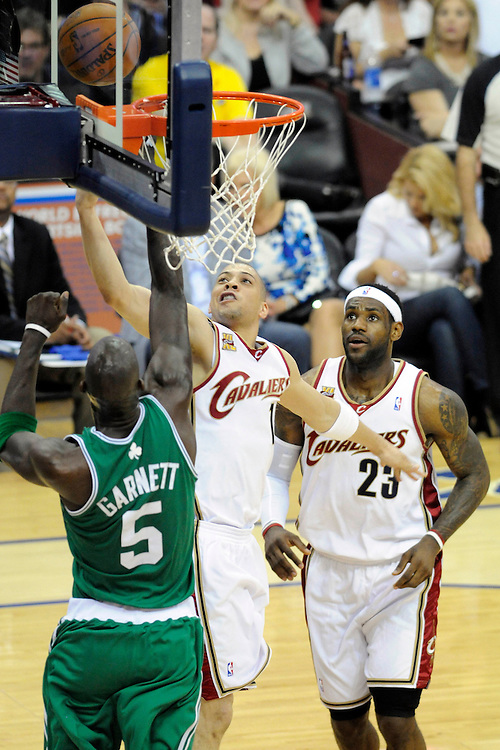 May 1, 2010; Cleveland, OH, USA; Cleveland Cavaliers guard Anthony Parker (18) shoots over Boston Celtics forward Kevin Garnett (5) with Cleveland Cavaliers forward LeBron James (23) waiting for a rebound during the first quarter of game one in the eastern conference semifinals in the 2010 NBA playoffs at Quicken Loans Arena. Mandatory Credit: Dave Miller-US PRESSWIRE
