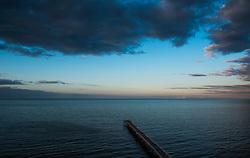 © Licensed to London News Pictures. <br /> 23/03/2015. <br /> <br /> Saltburn, United Kingdom<br /> <br /> Saltburn pier points northwards out to sea as evening light descends over Saltburn in Cleveland.<br /> <br /> Photo credit : Ian Forsyth/LNP