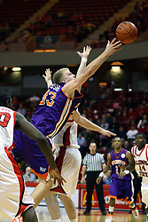 30 January 2007: Matt Webster leans in for a 2 pointer. The Purple Aces of Evansville folded the final 2 minutes of play and handed the game to Illinois State University Redbirds by a score of 65-61at Redbird Arena in Normal Illinois.