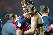A distraught Doncaster Rovers forward John Marquis (9) is comforted by Doncaster Rovers defender Joe Wright (5) after the EFL Sky Bet League 1 second leg Play-Off match between Charlton Athletic and Doncaster Rovers at The Valley, London, England on 17 May 2019.