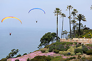 Paragliders sail over the cliffs in La Jolla, CA on May 8, 2013.