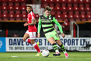 Forest Green Rovers Charlie Cooper(15) passes the ball forward during the EFL Trophy match between Swindon Town and Forest Green Rovers at the County Ground, Swindon, England on 5 December 2017. Photo by Shane Healey.