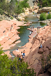 Sedona, Arizona:  Swimming, slipping, and sliding in the natural waterfalls of Oak Creek is the prime offering of Slide Rock State Park, seven miles north of town via Highway 89A.