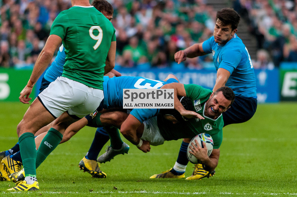 Dave Kearney of Ireland is tackled. Action from the Ireland v Italy pool game at the 2015 Rugby World Cup at Queen Elizabeth Stadium in London, 4 October 2015. (c) Paul J Roberts / Sportpix.org.uk