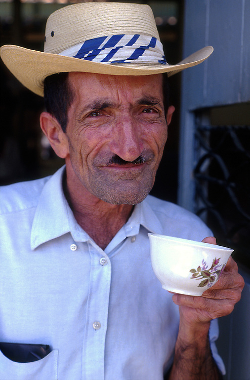 COLOMBIA: Manizales, Coffee region (Zona Cafetero).A local man in El Jardin, sips a cup of tinto - black coffee, not for export.