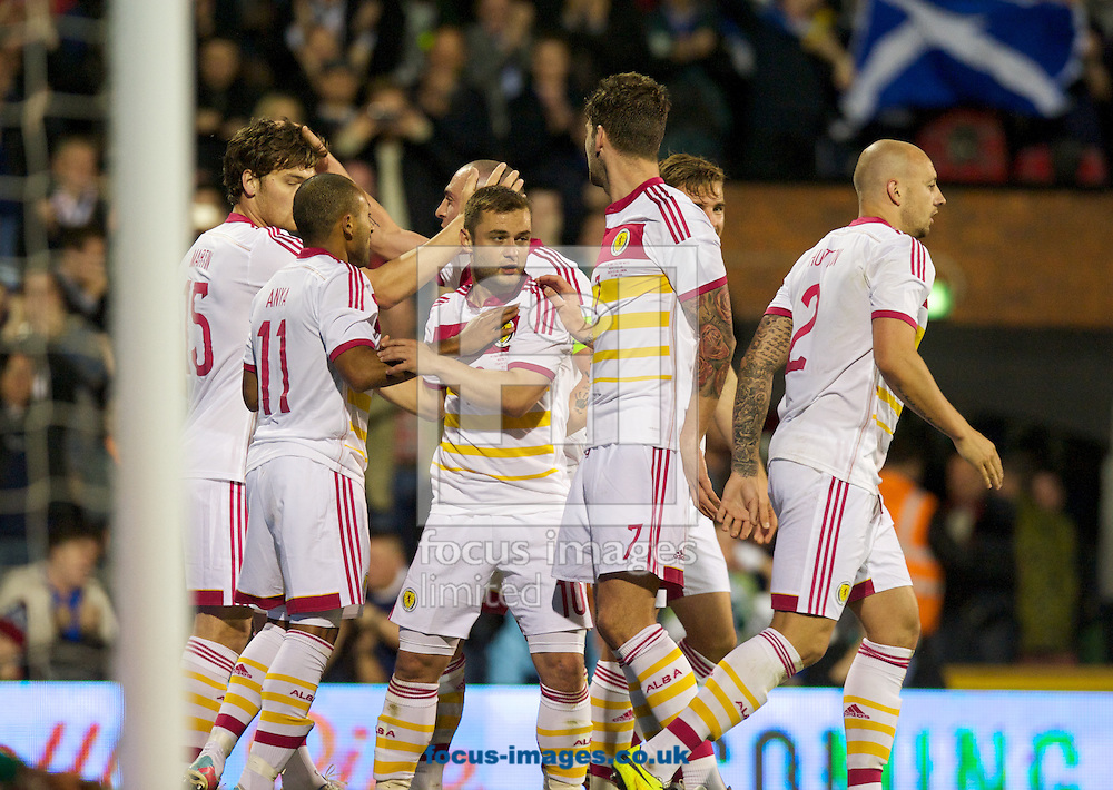 Scotland players celebrate their 2nd goal during the International Friendly match at Craven Cottage, London<br /> Picture by Alan Stanford/Focus Images Ltd +44 7915 056117<br /> 28/05/2014