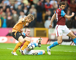 WOLVERHAMPTON, ENGLAND - Saturday, October 24, 2009: Aston Villa's Richard Dunne pulls back Wolverhampton Wanderers' Kevin Doyle during the Premiership match at Molineux. (Photo by David Rawcliffe/Propaganda)
