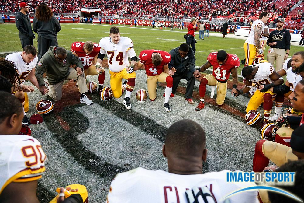 Nov 23, 2014; Santa Clara, CA, USA; San Francisco 49ers and Washington Redskins players pray after game at Levi's Stadium.