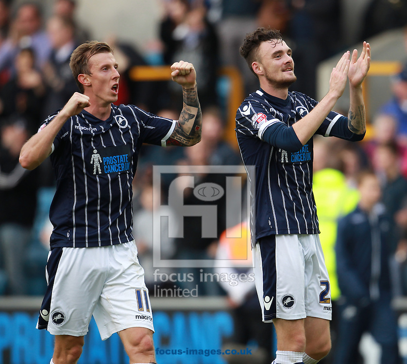 Picture by John Rainford/Focus Images Ltd +44 7506 538356<br /> 28/09/2013<br /> Goalscorers Martyn Woolford and Scott Malone of Millwall salute the fans after the Sky Bet Championship match at The Den, London.