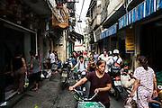 Bustling narrow alley in Hanoi's Old Quarter, Vietnam, Southeast Asia