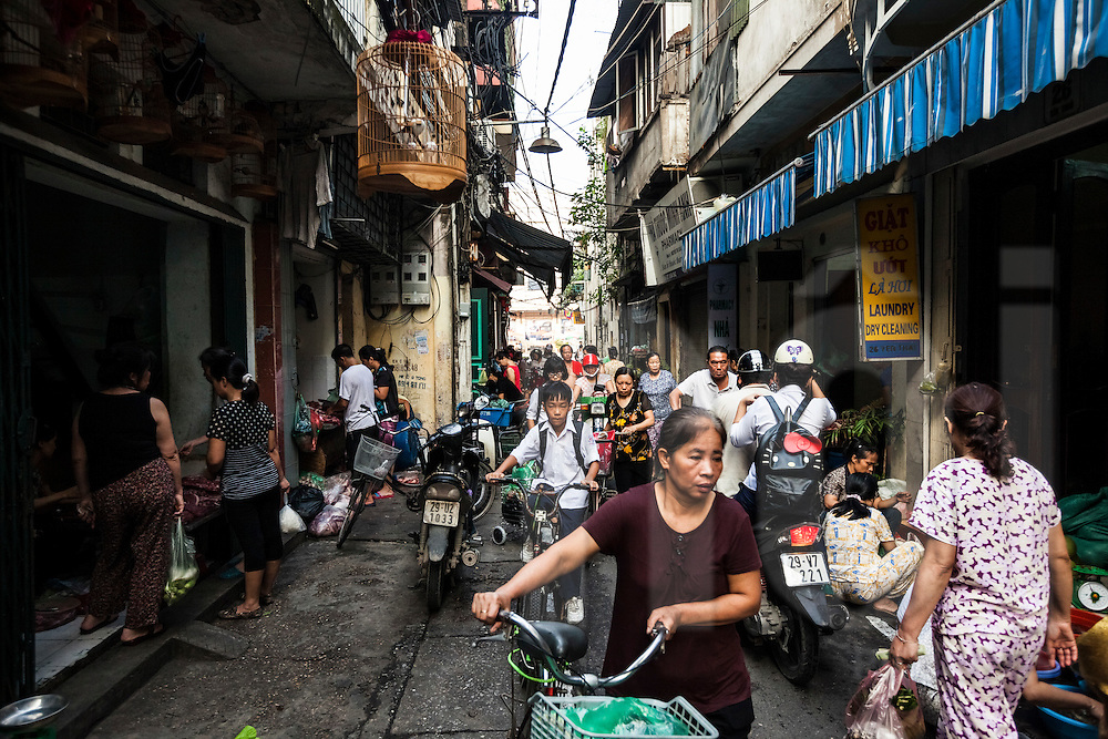 Bustling narrow alley in Hanoi's Old Quarter, Vietnam, Southeast Asia