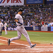New York Yankees shortstop Derek Jeter (2) tags up and scores a run during a major league baseball game between the New York Yankees and the Tampa Bay Rays at Tropicana Field on Thursday, Sept. 17, 2014 in St. Petersburg, Florida. The Yankees won the game 3-2 and this was Jeter's last game against Tampa Bay. (AP Photo/Alex Menendez)
