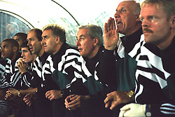 VLADIKAVKAZ, RUSSIA - Tuesday, September 12, 1995: Liverpool's manager Roy Evans on the bench against FC Alania Spartak Vladikavkaz with his back-room staff Doug Livermore, coach Ronnie Moran, Dr Mark Waller and physio Mark Leather during the UEFA Cup 1st Round 1st Leg match at Republican Spartak Stadium. (Photo by David Rawcliffe/Propaganda)
