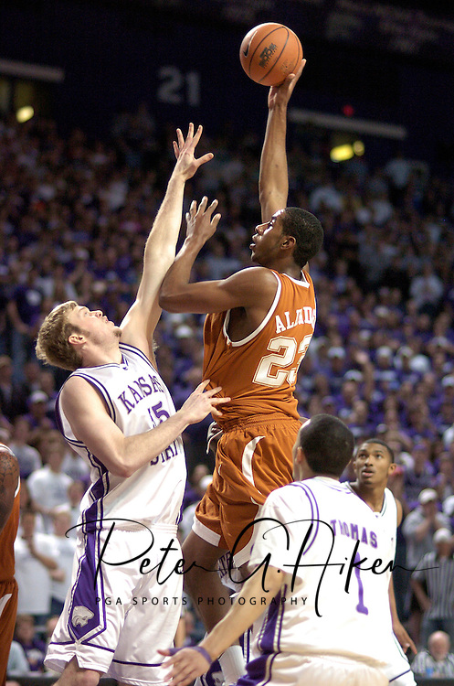 Texas forward Lamarcus Aldridge (R) scores over Kansas State center Tyler Hughes (L), during the first half at Bramlage Coliseum in Manhattan, Kansas, February 22, 2006.  The Longhorns lead at halftime 42-36.