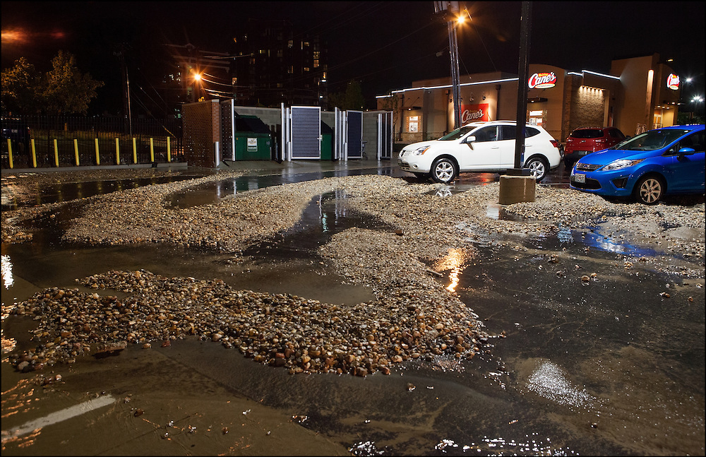 Westport in Kansas City, Missouri experienced flooding that submerged cars and businesses pushing rocks into a parking lot.