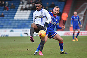 Bury Midfielder, Kelvin Etuhu guards the ball against an Oldham advance during the Sky Bet League 1 match between Oldham Athletic and Bury at Boundary Park, Oldham, England on 23 January 2016. Photo by Mark Pollitt.