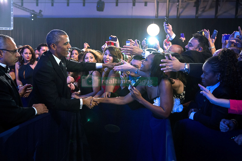 President Barack Obama greets audience members at the Congressional Hispanic Caucus Institute's 37th Annual Awards Gala dinner at the Walter E. Washington Convention Center in Washington, D.C., Oct. 2, 2014.  (Official White House Photo by Chuck Kennedy)<br /> <br /> This official White House photograph is being made available only for publication by news organizations and/or for personal use printing by the subject(s) of the photograph. The photograph may not be manipulated in any way and may not be used in commercial or political materials, advertisements, emails, products, promotions that in any way suggests approval or endorsement of the President, the First Family, or the White House.