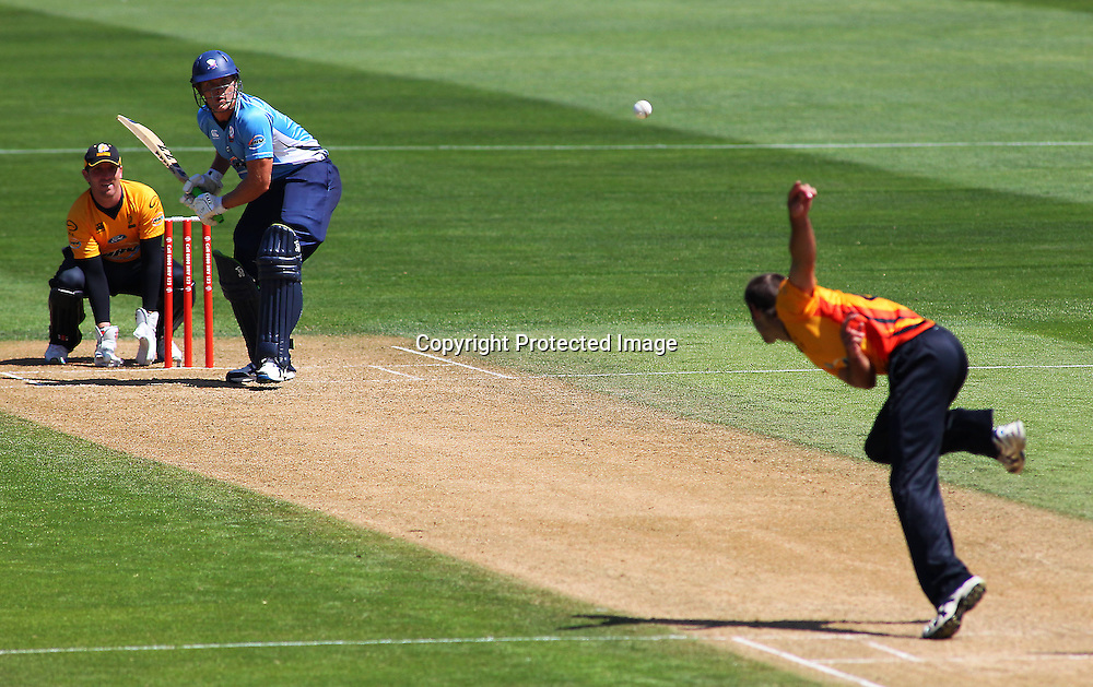 Grant Elliott bowls to Michael Bates during their Twenty20 Cricket match - HRV Cup, Wellington Firebirds v Auckland Aces, 28 December 2011, Hawkins Basin Reserve, Wellington. . PHOTO: Grant Down / photosport.co.nz