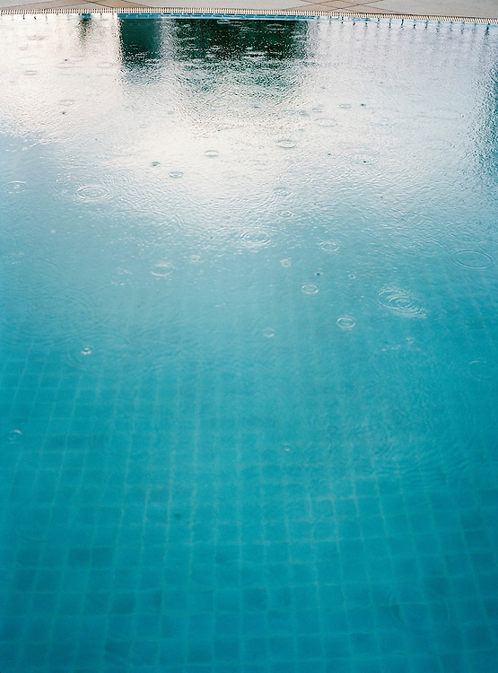 Rain drops on a swimming pool.